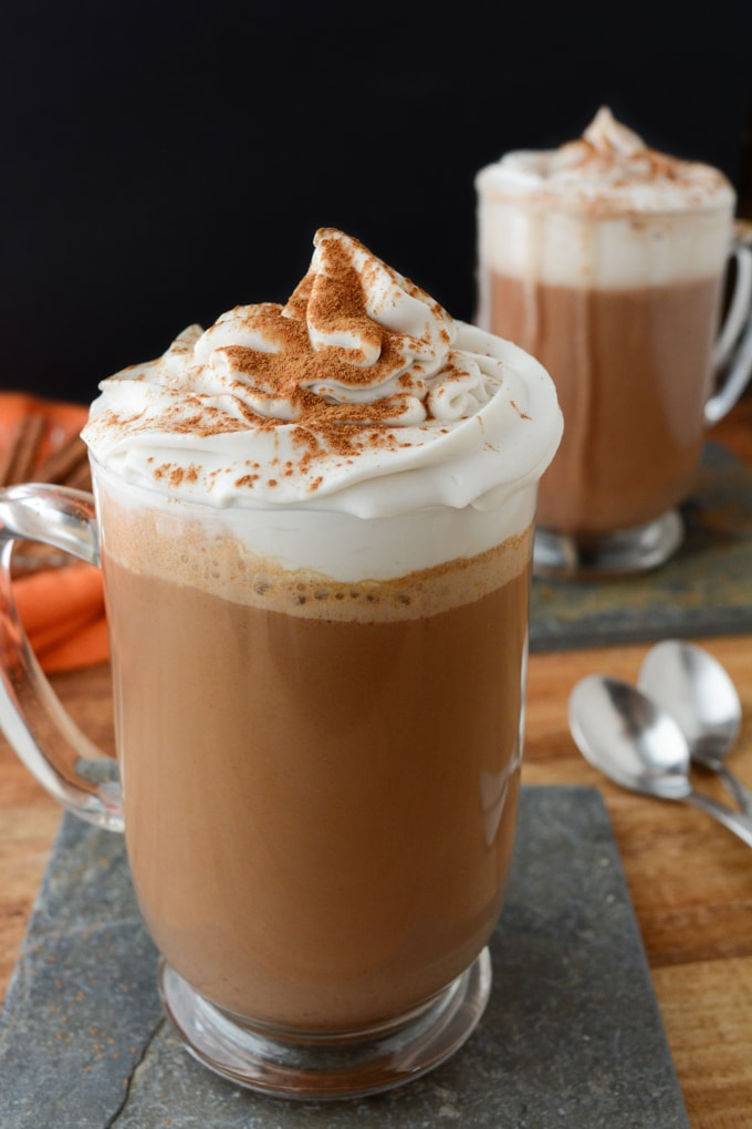 Cozy up this season with Vegan Pumpkin Spice Hot Chocolate!  It's made with real pumpkin puree!  Make a batch for the family or bring it in the slow cooker to your next holiday gathering.