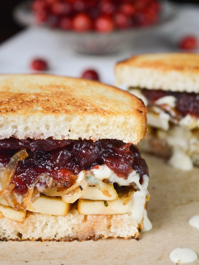 Vegan Holiday Sandwich- herb tofu, caramelized onions, savory herb dressing and cranberry sauce on toasted sourdough bread.
