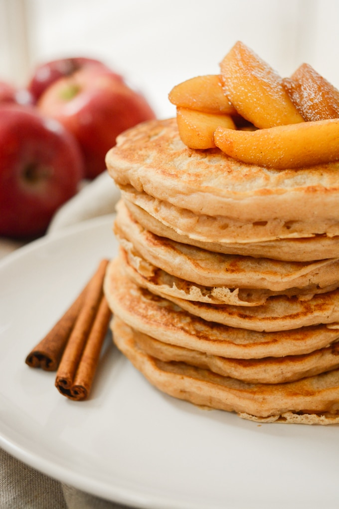 Apple Cinnamon Pancakes are topped with cooked apples.