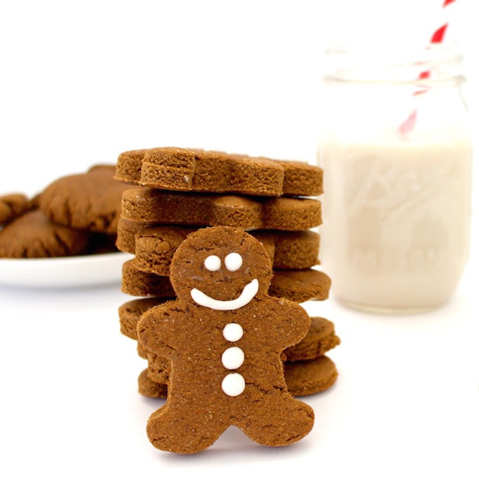Vegan Holiday Cookie - Cute gluten-free gingerbread man with a glass of non-dairy milk.