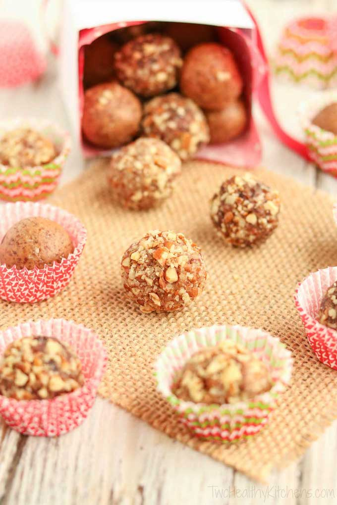 Vegan Holiday Cookie - No-Bake gingerbread date balls spilling out of a gift bag.