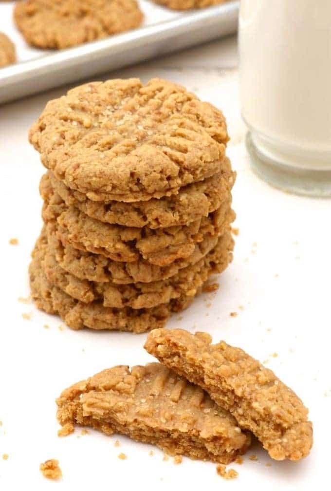 Vegan Holiday Cookie - Stack of no-chill vegan peanut butter cookies with a glass of almond milk.