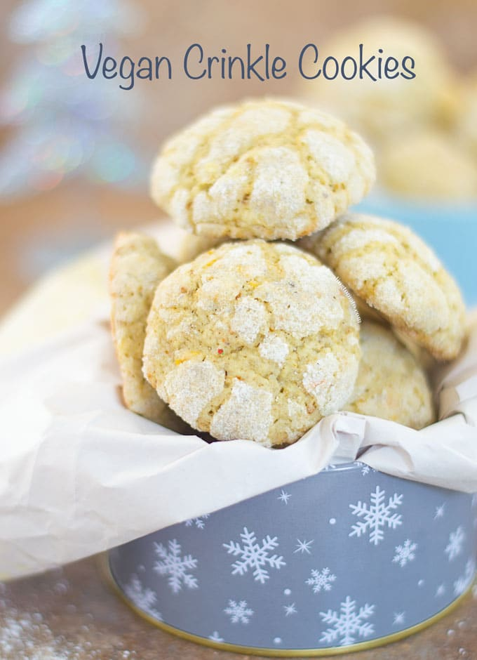 Vegan Holiday Cookie - Lemon crinkle cookies piled in a festive tin.