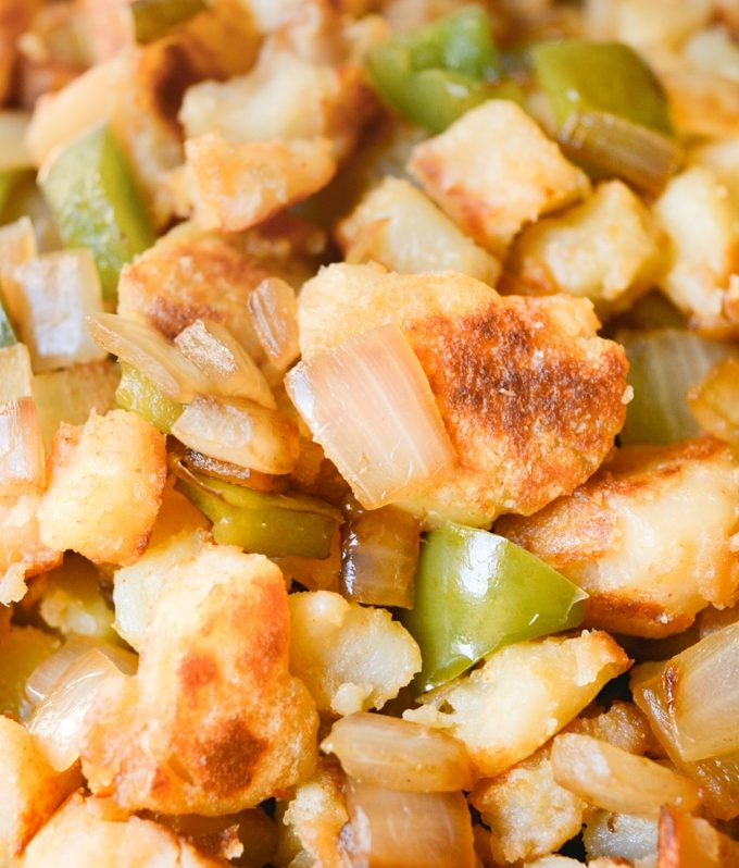 Close up of browned breakfast potatoes with onions and bell peppers.